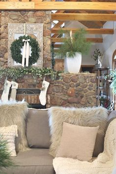 Christmas wreath on mirror over fireplace