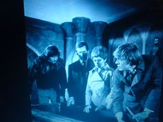 Surprise in a coffin... in 'Les Fleurs du Mal' (Department S, still photo, with Joel Fabiani (middle) and Michael Gothard (f.g.) )