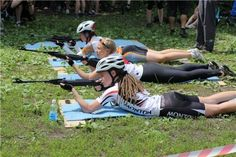 Russian girls shoot rifles in a biathlon competition
