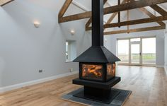 The 45 ft lounge in Featherdown, Cavil Head Farm with stunning centre fire place Home Fireplace, Firewood, Centre, Barn, Lounge, Home Appliances, Luxury, Airport Lounge, House Appliances