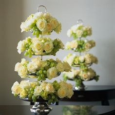 Try something different...use a cupcake stand for your flowers. They can be a centerpiece or use it for your sign in table...