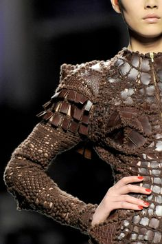 Jean Paul Gaultier Couture Animal Skin & Crochet Lace.  I have seen this in person and the picture doesn't do it justice.  Absolutely LOVE THIS!!
