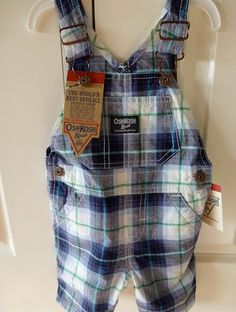 Cute OshKosh overalls in blue, white and green checks. Adjustable straps, 3 pockets at front and two at back. Two snaps at bottom for ease of changing.