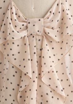 Love the back detail and the pattern. Flash Fete Top in Dots. When you styled this cream blouse with tiny black dots this morning, you never suspected it would become party apparel! #cream #modcloth