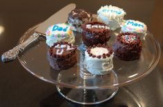 """The mini cakes are really oreos with a layer of frosting between them, then more frosting on tops and sides...plus decorations. The cakes should """"rest"""" before anyone tries cutting a slice so the oreos have a chance to soften and become, cake-like."""
