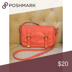"Coral Crossbody Purse This purse will be the perfect match for your summer outings. This small yet roomy bag will allow you something portable and convenient for whatever you need for a night out, and the crossbody feature will allow you to freely go about your day. Definitely a fashion accessory you need in your closet! Approximate Dimensions: 10.5"" long, 6"" tall, and 2.5"" wide! Charming Charlie Bags Crossbody Bags"