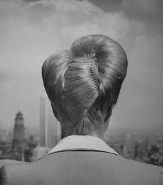 Fashionable upsweeping hairstyle 1943 Photographed for LIFE Magazine.
