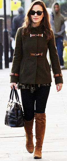 December 2, 2011 - Pippa Middleton kept warm in an army green Fay funnel coat, black jeans, and brown boots. She accessorized with her handy Modalu snakeskin black bag.