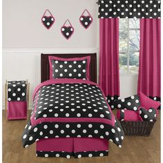 This bright bedding set by Sweet Jojo Designs creates a stunning boutique setting for your young fashionista. The comforter and shams have a gorgeous black, white and hot pink design that will set your child's room in high style.