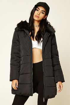 A parka jacket featuring a faux fur-lined hood, zip-up front, front flap pockets, long sleeves, front zippered pockets, faux shearling lining, a partial zippered back, and a drawstring waist.