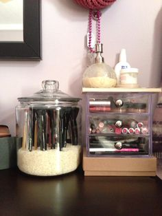 my make-up storage: glass jar from Crate, 3 drawer storage from The Container Store