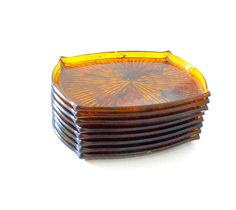 ☛vintage recycled eco friendly SOLD at www.etsy.com/shop/paroliro to Kenilworth, Illinois ~ 8 amber honey tortoise ornate starburst pattern nesting cocktail or tapas plates from Mad Men era 1960s, stored in clear plastic box; rare and retro; 7/14 inches by 5 3/4 inches; [Click on image for full details]; ☚
