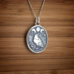 This sterling silver raven pendant is wonderfully detailed, with a raven looking upon the triple moon. The design was actually created by my
