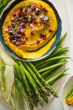 Roasted Pumpkin Hummus.with  roasted garlic and tahini for that savory, nutty flavor with crunchy textures from the pepitas and hemp hearts. The pomegranate seeds  bring a sweet/tart and savory combination.