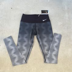 NIKE DRI-FIT Women's Ombré Tights NWT Nike Golf DRI-FIT Women's Ombré Full Length Tights. Size XS. Thin stripes of black and shades of gray. Hidden Pocket on the waistband for keys or valuables. Perfect for running or any type of workout! Nike Pants Leggings