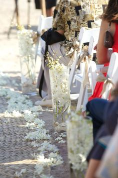 Aisle decor for ceremony. White dendrobium orchids, lauhala mat