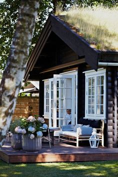 French doors to raised deck :: Quaint log cabin with a meadow roof :: Stunning cozy space