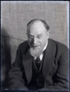 """Erik Satie, Paris 1922. By Man Ray. On their first encounter, Man Ray described Erik Satie as """"a strange, voluble little man in his fifties […] who looked like an undertaker or an employee of some conservative bank"""". But he also said of him that he was """"le seul musicien qui avait des yeux""""."""