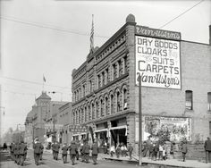 """Marquette, Michigan, circa 1913. """"Washington Street, showing opera house."""" Now playing at the picture show: """"Message From Mars"""" and """"Flaming Arrrow."""""""