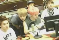 TAO AND LUHAN SO CUTE. TAO IS JUST TROLLING AND LUHAN JUST HIT HIM WITH A PAPER LUL LAAF EM. EXO