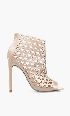 heart lasercut detailing on this genuine-leather bootie by BETSEY JOHNSON