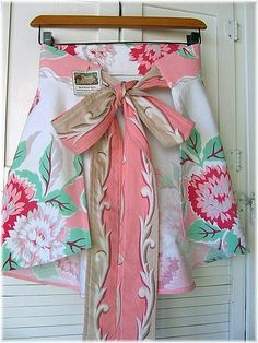 apron made from vintage tablecloths.  this is a way to use the tablecloths that are stained, just use the good part