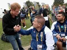 Prince Harry meets competitors at the Lee Valley Athletics Centre after a Drumhead Service during the Invictus Games on September 11, 2014