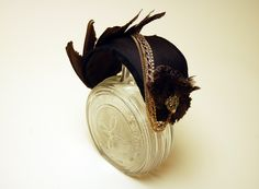 chain decorated curved fascinator