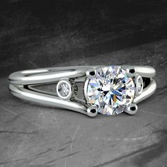 Diamond Accent Solitaire Engagement Ring in Platinum http://www.brilliance.com/engagement-rings/diamond-accent-solitaire-ring-platinum