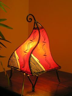 Small henna table top lamp in red. http://www.maroque.co.uk/showitem.aspx?id=ENT03216&p=01571&n=all