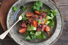 Spice up your weeknight cooking with a Thai salad that spotlights succulent beef strips, fresh veggies and aromatic herbs.