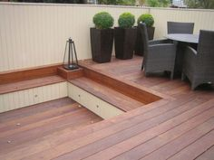 decks with sunken fire pit | Simple deck lights uplight the containers to provide dramaticshadows ...
