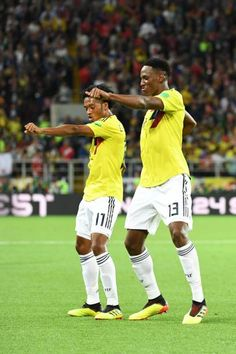 Colombia's defender Yerry Mina celebrates with Colombia's forward Juan Cuadrado after scoring the equalizer during the Russia 2018 World Cup round of. Football Match, Fifa World Cup, Cristiano Ronaldo, Soccer, Running, Celebrities, Russia, Sports, Colombia