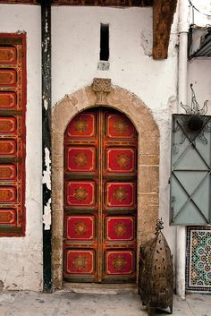 Front door Feng Shui love. Gilded. Red. Gorgeous. Mouth of ch'i.