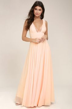 Lulus Exclusive! Make an upcoming occasion extra special with the True Bliss Peach Maxi Dress! Woven poly forms this elegant maxi dress with a lace trimmed, V-neckline, set-in waist, and cascading skirt. Hidden back zipper with clasp.