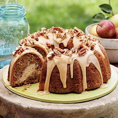 Apple-Cream Cheese Bundt Cake Recipe Desserts with cream cheese, soften, butter, granulated sugar, large eggs, all-purpose flour, vanilla extract, chop fine pecan, all-purpose flour, granulated sugar, brown firmly light packed sugar, ground cinnamon, salt, baking soda, ground nutmeg, ground allspice, large eggs, canola oil, applesauce, vanilla extract, gala apples, brown firmly light packed sugar, butter, milk, vanilla extract, powdered sugar
