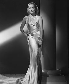 Carole Lombard circa 1935 - before the 50's latex (Lycra or Spandex or Elastane) had not been used in clothing, so how did they achieve this sultry look?....they cut it on the bias, so that it would fall over the star's body like liquid.