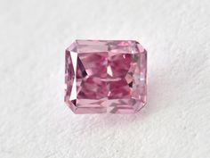 0.25 ct. Fancy Vivid Purple Pink, radiant, I1.