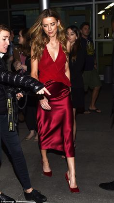 Cutting a fine figure: As she arrived for the red carpet, Amber gave another sizeable flas...