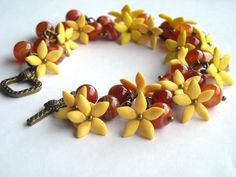 http://ic.pics.livejournal.com/li_za_ve_ta/19064497/115658/600.jpg - Clay Flowers bracelet in yellow and red - http://polymerclayfimo.livejournal.com/4434551.html