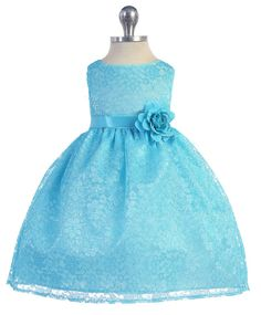Girls Dress Style 749- TURQUOISE Sleeveless Lace Dress with Ribbon Sash  Love love love this classic beautiful dress. The dress has a stunning lace overlay fabric that is classically styled. This style would be stunning on any holiday card and the ribbon sash comes on the dress with coordinating flower and it ties in the back for a perfect bow in the back.  http://www.flowergirldressforless.com/mm5/merchant.mvc?Screen=PROD&Product_Code=CA_B749TUR&Store_Code=Flower-Girl&Category_Cod..