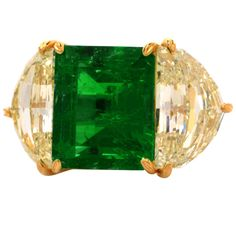 Impressive Emerald Diamond Gold Platinum Cocktail Ring | From a unique collection of vintage cocktail rings at https://www.1stdibs.com/jewelry/rings/cocktail-rings/