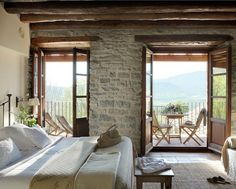 Tuscan bedroom.. love those stone walls!