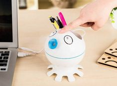 A pen holder that's trying to be hush hush about the fact that you can use it as a humidifier.