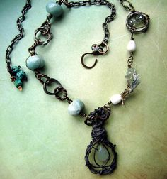 Captured Tears Of My Ocean by anvilartifacts on Etsy, $105.00....love the metal work on this