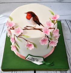 small handpainted cake with blossoms from @Hip-pop cakes