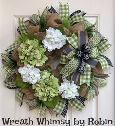 Burlap Mesh Hydrangea Wreath in Moss Green, Cream & Black. This fresh and modern natural jute wreath is perfect all year long. It contains 5 large hydrangea stems in a cream and striking green. A large bow and 20 ribbon steamers compliment the hues including; a green plaid
