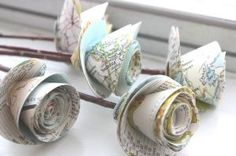 paper roses, a cheap alternative to a real flower boquet. write notes to each other and after having read them, you can now carry them down the aisle with you and keep for memories.