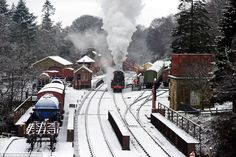 At Goathland Station, a steam locomotive passes beneath a bridge this morning in a stunning winter scene
