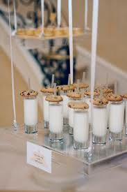 cookies and milk shots... If only I had seen this before the wedding I would have served cookies with the cake and milk!